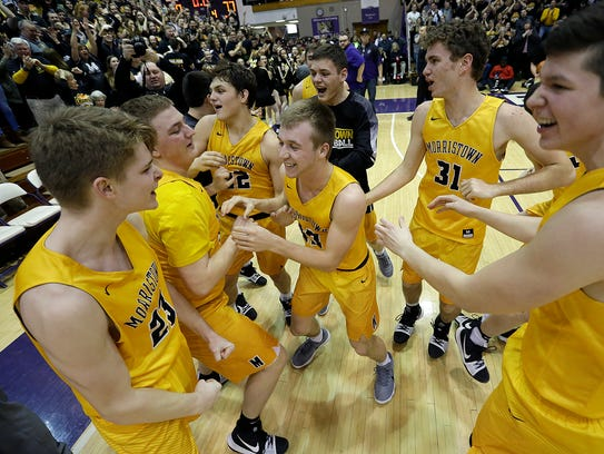 The Morristown Yellow Jackets celebrate their win over the Barr-Reeve Vikings of their IHSAA Boys Semi-State basketball game in Seymour IN., on Saturday, March 16, 2018.