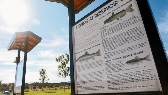 A fishing sign is posted July 23 near the entrance at Tiger Lake in Aztec.