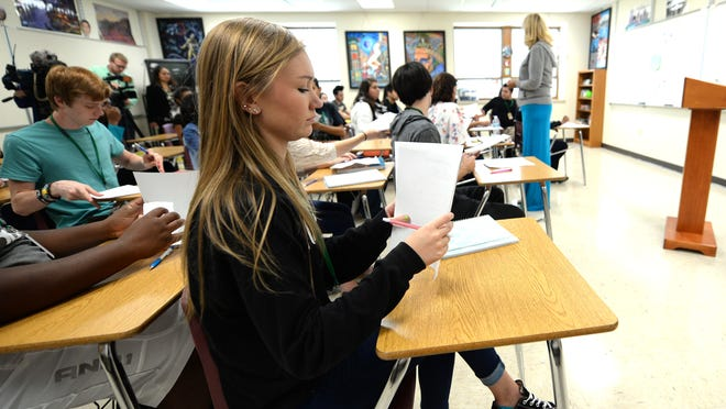 Preble High School student Megan Rasmussen fills out forms during her sociology class Monday at the school.