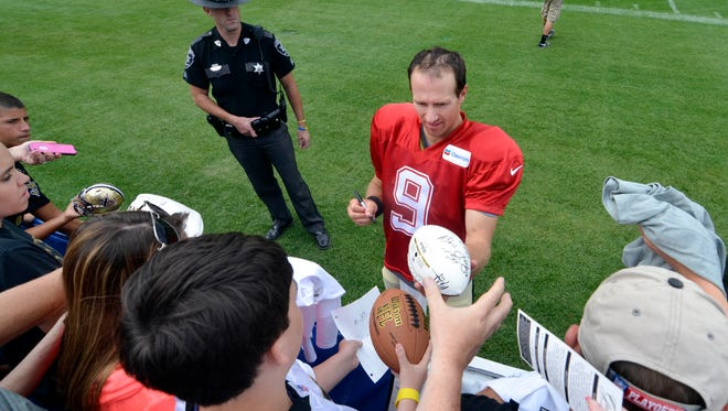 New Orleans Saints quarterback Drew Brees (9) signs autographs following training camp at The Greenbrier.