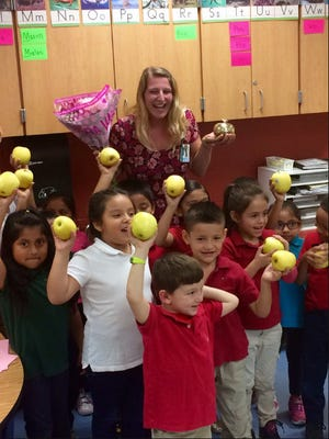 Ashley Heirls of Highlands Elementary School celebrates her Golden Apple Award with her class Feb. 14, 2017.