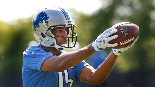 Detroit Lions wide receiver Golden Tate catches a ball during NFL football practice in Allen Park, Mich., Thursday, June 2, 2016.