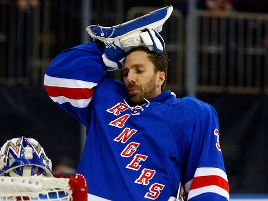 Henrik Lundqvist in action against the Calgary Flames.