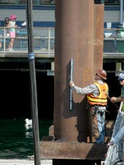Pilings to support a new, temporary dock for passenger only ferries were installed on Tuesday. The foot ferry terminal will move temporarily to the north side of Colman Dock while a new permanent facility is built on the south side.