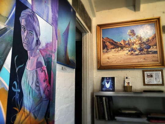"""The Agnes Pelton painting, """"Smoke Tree in Bloom,"""" hangs in the former home of the artist. The Cathedral City residence is owned by Peter Palladino and Simeon Den."""
