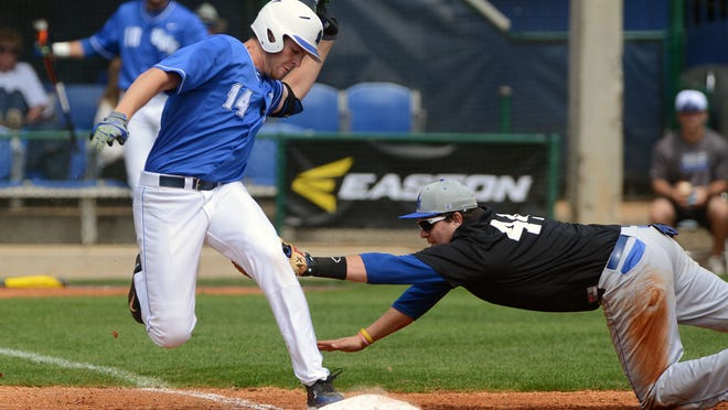 West Florida's Sean Plunkett (14) is safe at first as Alabama Huntsville's Trey Mathis tries to tag him out Sunday afternoon. West Florida beat Alabama Huntsville 4-2.