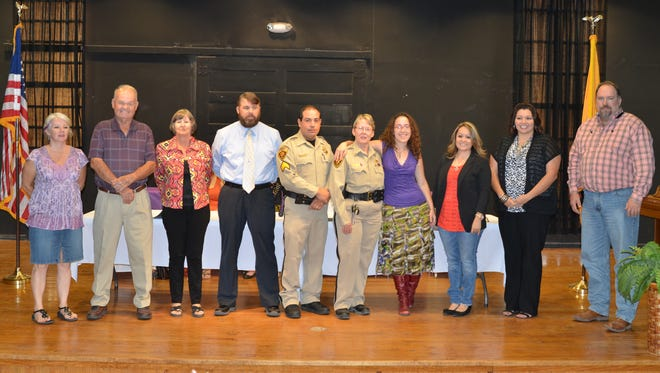 """Winners of the Healing House's Hope Award are shown with program director Irene Trejo. They are, from left: Gretchen Bolsins, Don Hill, Lynn Manning, Lt. Matt Rudiger, Sgt. Luis Malina, Lt. Joy Mullins, Cassandra Brulotte, Sonia Gonzales, Trejo and Charles """"Tink"""" Jackson."""