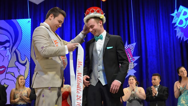 Joshua Sheppard is crowned Mr. Millville Thursday evening by 2015 winner Billy Forte.