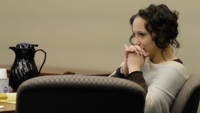 Amber Speed watches as her attorney, Patrick O'Keefe, makes his closing arguments during Speed's trial on Friday, Jan. 5, 2018 in Ingham County Circuit Court.
