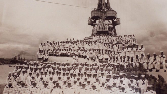 The crew and officers of the USS Augusta.