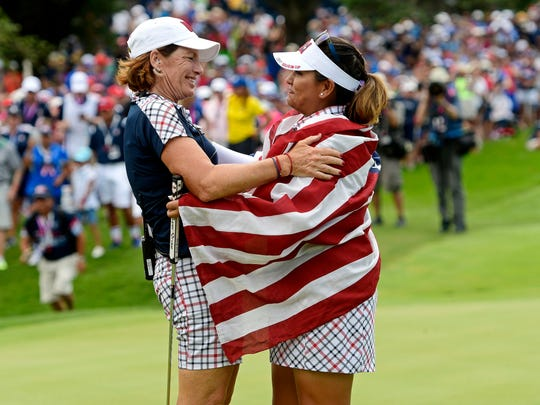 USA captain Juli Inkster celebrates with Lizette Salas after winning the The Solheim Cup international golf tournament at Des Moines Golf and Country Club. (Thomas J. Russo-USA TODAY Sports)