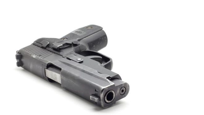 Black Pistol Isolated on White