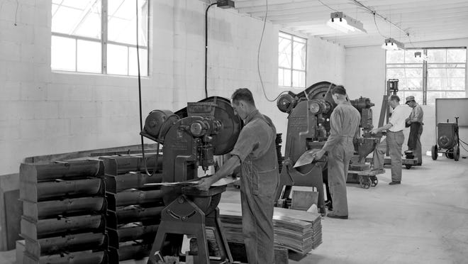 Roy G. Miller workers fabricate troughs in the Monmouth factory in 1947. Miller himself can be seen in the white shirt.