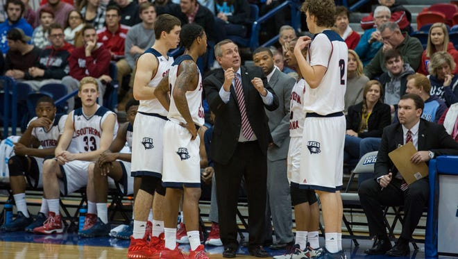 USI's Head Coach, Rodney Watson, talks to his players at a timeout during Sunday night's game against Lees-McRae.