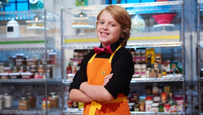 "Contestant Anthony Smith during the challenge ""Bake Sale"" as seen on Food Network's Kids Baking Championship, Season 1."