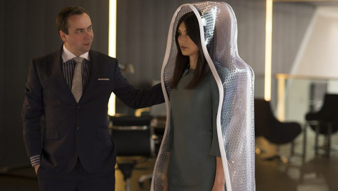 A synth salesman rolls out Anita (Gemma Chan) in AMC's artificial-intelligence drama 'Humans.'
