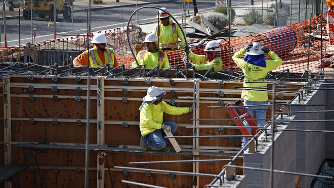 Workers pour concrete into forms for hydrotherapy pools as part of the renovation of the clubhouses at Surprise Stadium, home of the Kansas City Royals and the Texas Rangers, on August 21, 2015.