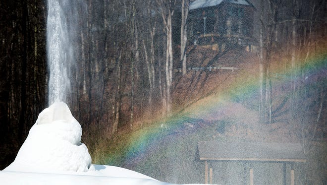 Water droplets coming out of Andrews Geyser reflect light to form a rainbow in the morning light of Tuesday Feb. 16.