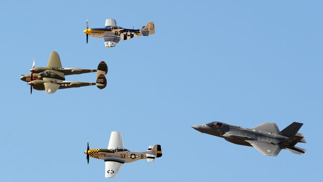 The modern-era F-35A Lightning II (right) flies with a World War II-era P-38 Lightning (left)  and P-51 Mustangs (top and bottom) during a qualifying run for the Heritage Flight team at Davis-Monthan Air Force Base, in Tucson, earlier this month.