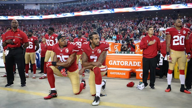 San Francisco 49ers Eric Reid (35) and Colin Kaepernick (7) take a knee during the National Anthem prior to their season opener Sept. 12, 2016.
