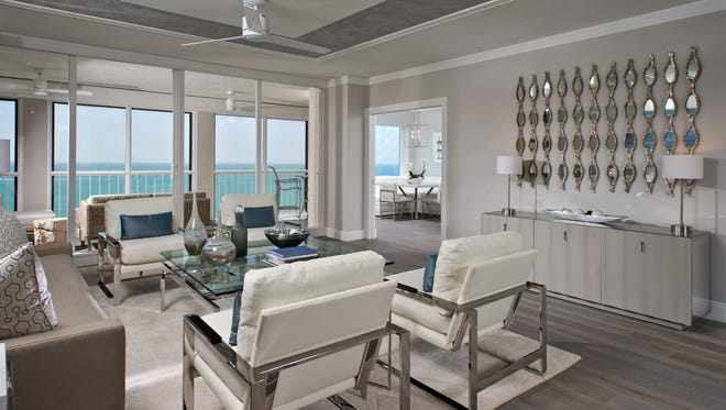 Tranquil neutral backgrounds and stylish transitional décor create a chic yet inviting living room in this condominium overlooking the Gulf.  This space was awarded Interior Design of the Year, for an attached single family home, in the 2016 Sand Dollar Awards.