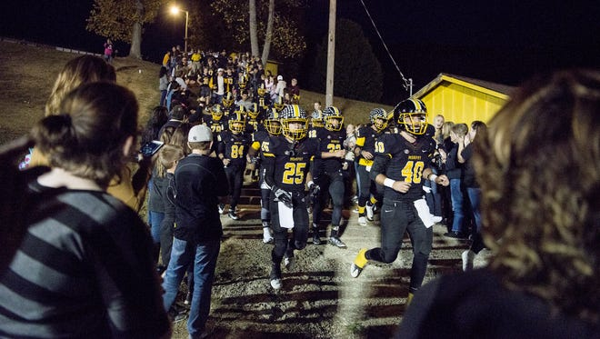 Murphy football players take the field for a recent home game against Swain County.