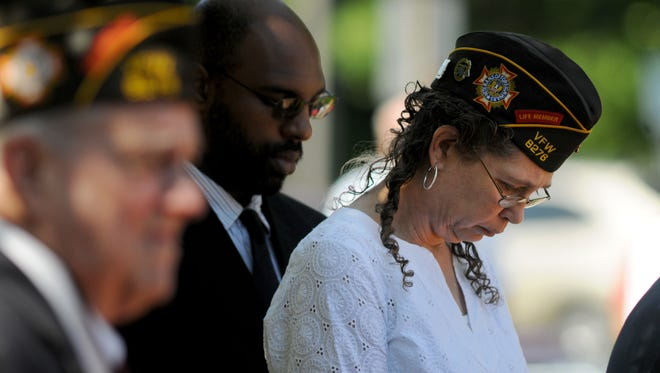 Members of the VFW bow their heads as names of fallen members of the military are read off during Memorial Day services at the Wicomico Youth & Civic Center in Salisbury in 2014. The annual event will be held again on May 29, 2017.