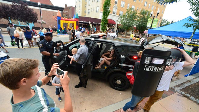 Residents try out police equipment during last year's National Night Out.
