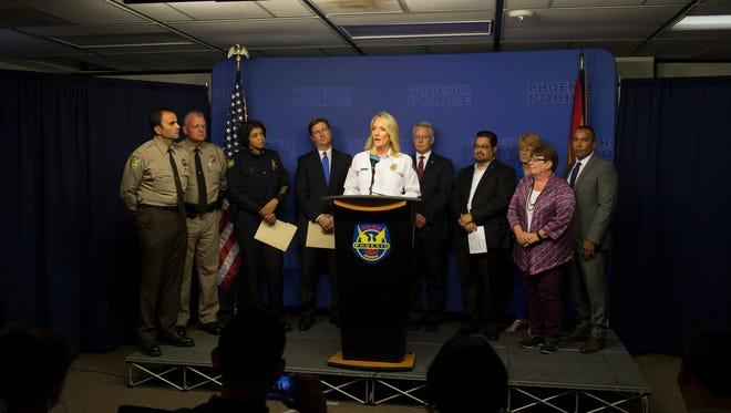 Phoenix Fire Chief Kara Kalkbrenner speaks during a public safety briefing Aug. 21, 2017, at the Phoenix Police Department in Phoenix.