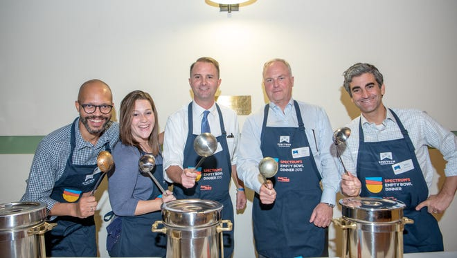 Craig Mitchell, from left, Melissa Sheketoff, Attorney General T.J. Donovan, John Brumsted and Burlington Mayor Miro Weinberger serve at the Empty Bowl fundraiser for Spectrum Youth and Family Services on Oct. 12.