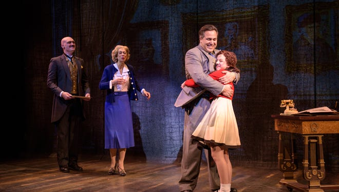 "Alex Campea (left) and Diane Lane smile as Andrew Varela hugs KyLee Hennes in ""Annie,"" performed by Skylight Music Theatre."