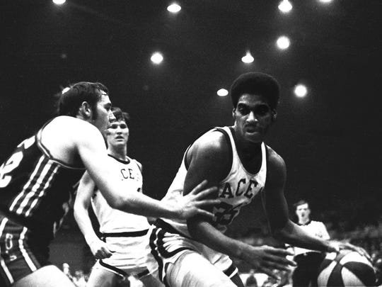 Sat 12/11 Flashback                                                                                                 Indiana Pacer Roger Brown drives around an unidentified Bucs player. The characteristic red white and blue ball used by the ABA. The ball may be making a comeback next season in the xxx xxx League. Photo by Indianapolis News photographer Jim Young Jan. 27 1970