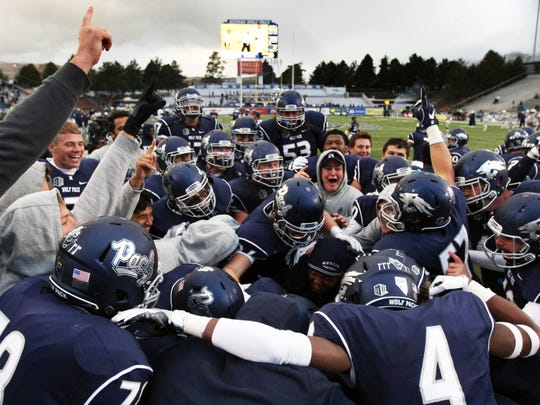 The Wolf Pack football team, shown celebrating a win over Utah State last season, opens the 2017 campaign on Sept. 2 at Northwestern.
