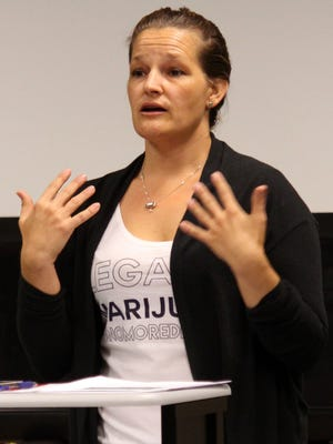 Jessica Gelay of Drug Policy Alliance delivers a speech to a small crowd about the possible benefits of legalizing marijuana in New Mexico Thursday. The meeting, held at the Mimbres Valley Learning Center, was open to the public to learn about the facts of legalizing marijuana.