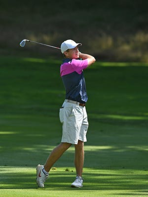 Connor Bennink hits his fairway shot on the fifth hole, Aug. 14, 2020, during the first round of the EDGA Amateur Championship at the Kahkwa Club in Fairview Township. Bennink hit a 74 in the centennial EDGA golf championship event.