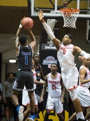 Lee-Montgomery's Demond Robinson blocks Auburn's Trey