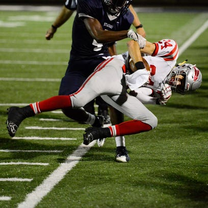 Bellevue's Dakota McPeak takes the ball out of bounds