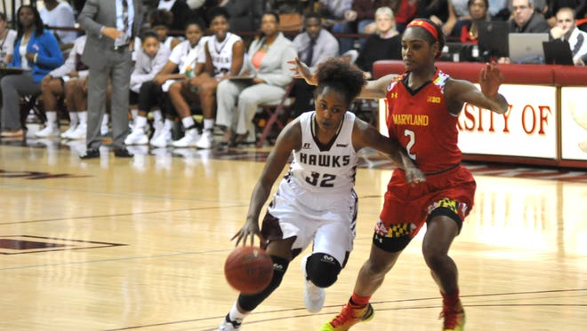 UMES's Keyera Eaton drives to the basket against Maryland's Kiara Leslie on Sunday, Dec. 20 at the William P. Hytche Athletic Center.