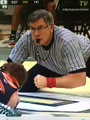 Les Rasmussen will retire from officiating wrestling after next week's state tournament.