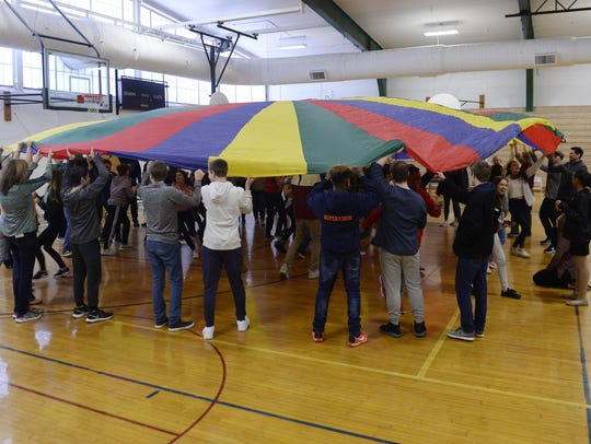 "Students participate in the game of ""parachute"" during"