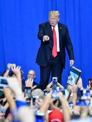 President Donald Trump reaches out to supporters during a rally at Municipal Auditorium, Tuesday, May 29, 2018, in Nashville, Tenn.
