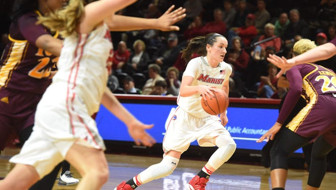 Maura Fitzpatrick drives in the Marist College women's basketball team's game against Iona on Jan. 26.
