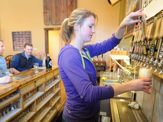 Courtney Lewallen fills a pint at Pateros Creek Brewing