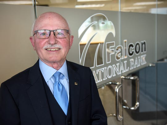 Falcon National Bank CEO John Herges stands at an entrance