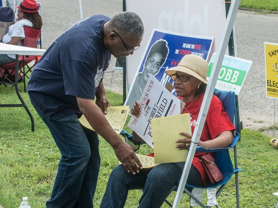 Robert Porterfield, candidate for Montgomery County Board of Education's District 6, speaks with one of his campaign supporters during voting at Beulah Baptist Church in Montgomery on Tuesday, June 5, 2018.