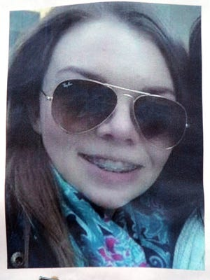 A photo of 16-year-old Paige Stalker of Grosse Pointe Woods, Mich., was stapled to a power pole in Detroit on Dec. 23, 2014, one day after a gunman opened fire on a car of teenagers.