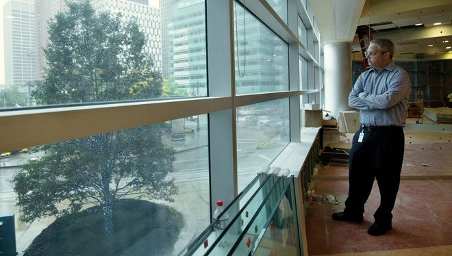 Benzinga Founder and CEO, Jason Raznick looks at view of Downtown Detroit from his new office inside the One Campus Martius building formerly known as the Compuware building on Tuesday, September 29, 2015, in Detroit. Benzinga, a young financial info business based in Southfield, will soon move its headquarter and about 30 people to the new Detroit location.