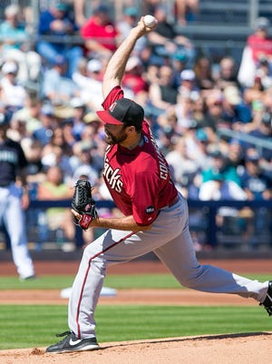 Diamondbacks starter Josh Collmenter pitches against the Mariners at Peoria Sports Complex in Peoria on Saturday, March 7, 2015.