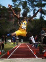 Rickards senior Devondrick Miller long jumps at the