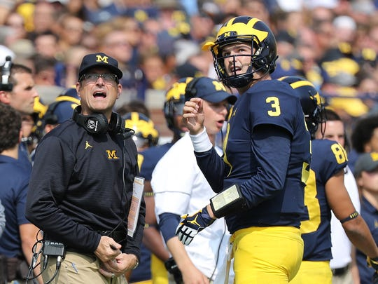 Michigan coach Jim Harbaugh and quarterback Wilton